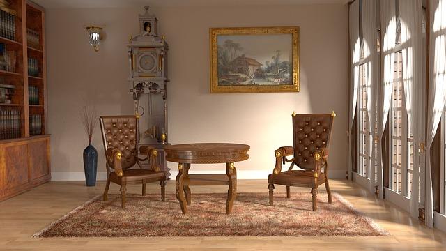 王室の部屋にイスやテーブル、額縁に飾られた絵などがある